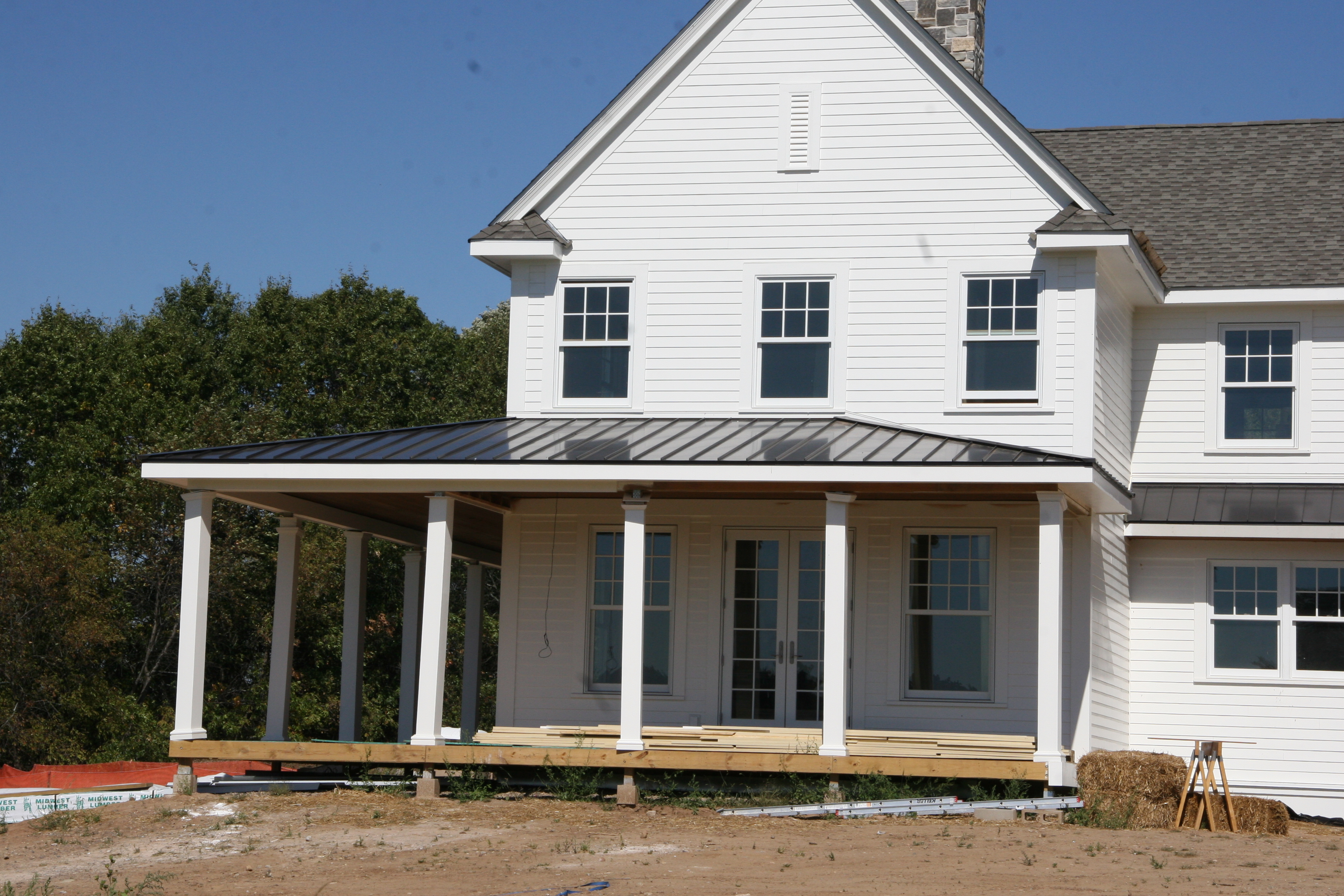 The roof the roof the roof is on week 27 robertshome for Metal roof porch pictures